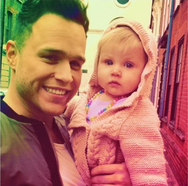 Celebrity photos: Olly Murs has been hanging out in America ahead of his tour with One Direction in a couple of weeks time. Whilst he takes in the sights, he's also been meeting new fans – including this cute little one.