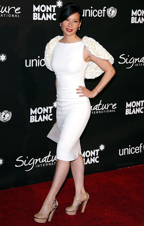 "Lucy Liu worked the red carpet at a UNICEF benefit in a wonderful white Giambattista Valli sheath dress, textured wool cape, and beige platform heels. Jean Baptiste Lacroix/<a href=""http://www.wireimage.com"" target=""new"">WireImage.com</a> - February 20, 2009"