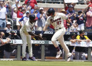 Atlanta Braves' Austin Riley (27) celebrates with third base coach Ron Washington after hitting a two-run home run in the fourth inning of a baseball game against the Pittsburgh Pirates,, Sunday, May 23, 2021, in Atlanta. (AP Photo/Tami Chappell)