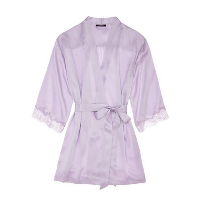 """Instead of getting her another terry cloth bathrobe, gift her this silk number. The lavender is so pretty and the lace-trim makes it that much more special. $224, Journelle. <a href=""""https://www.journelle.com/products/journelle-charlotte-short-robe-144359?color=1490"""" rel=""""nofollow noopener"""" target=""""_blank"""" data-ylk=""""slk:Get it now!"""" class=""""link rapid-noclick-resp"""">Get it now!</a>"""