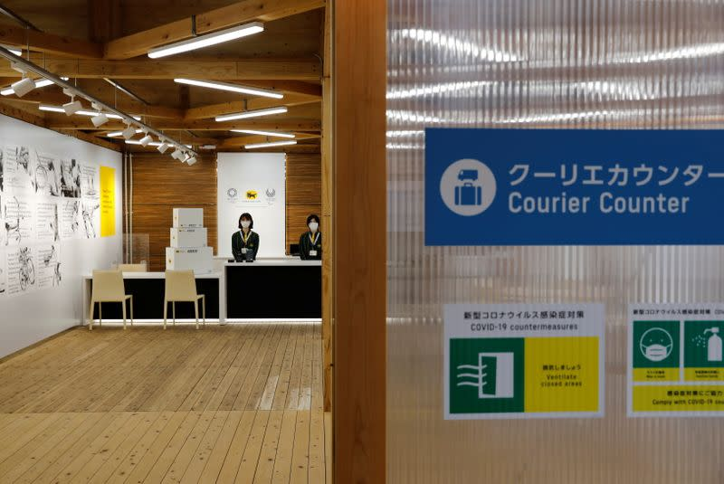 A courier counter at the village plaza of the Tokyo 2020 Olympic and Paralympic Village is pictured in Tokyo
