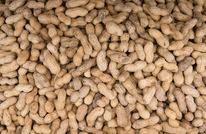 Eating peanuts, in small amounts, may reduce the risk of mortality, especially death from cardiovascular disease, a new study Monday showed (AFP Photo/Saul Loeb)