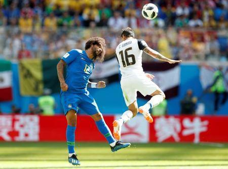 Soccer Football - World Cup - Group E - Brazil vs Costa Rica - Saint Petersburg Stadium, Saint Petersburg, Russia - June 22, 2018 Brazil's Marcelo in action with Costa Rica's Cristian Gamboa REUTERS/Carlos Garcia Rawlins