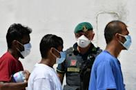 The interior ministry has said the army would guard reception centres to prevent migrants from escaping mandatory quarantine