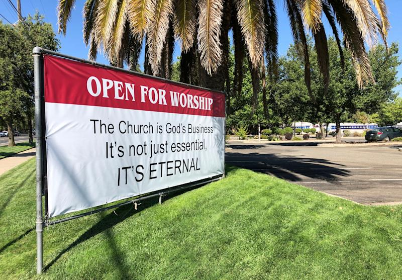 "An ""Open for Worship"" banner is posted outside the Crossroads Community Church in Yuba City, California, on July 9. (Photo: (AP Photo/Adam Beam))"