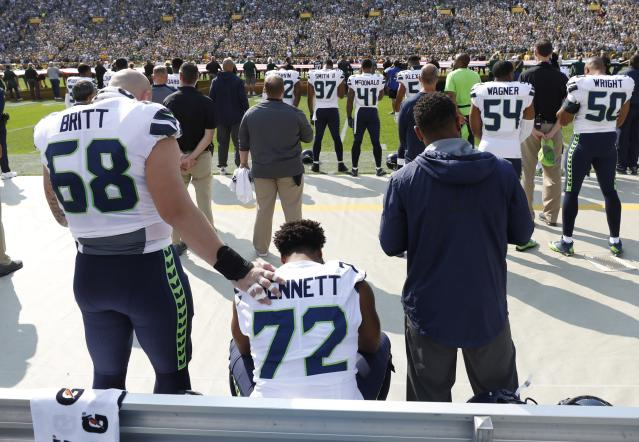 <p>Seattle Seahawks' Michael Bennett remains seated on the bench during the national anthem before an NFL football game against the Green Bay Packers Sunday, Sept. 10, 2017, in Green Bay, Wis. (AP Photo/Jeffrey Phelps) </p>