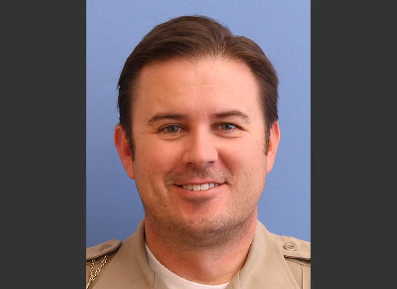 In this undated photo provided by the Utah County Sheriff's Office shows Sgt. Cory Wride. Officials say Utah County sheriff's Sgt. Cory Wride had stopped to check on a truck that appeared to be disabled on a two-lane highway Thursday, Jan. 30, 2014. He was using his computer to do a background check when he was shot from the truck and killed. (AP Photo/Utah County Sheriff's Office)