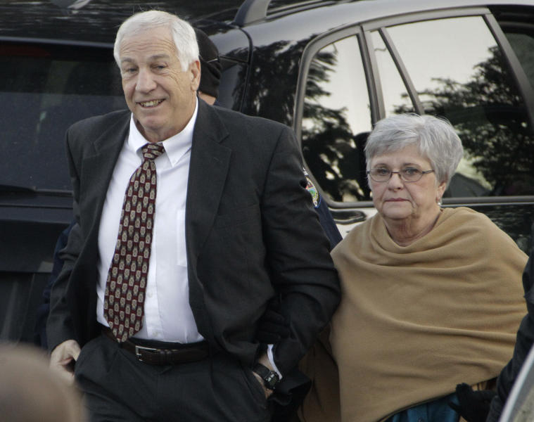 """FILE - In this Dec. 13, 2011 file photo, former Penn State assistant football coach Jerry Sandusky arrives with his wife, Dottie Sandusky, for a preliminary hearing at the Centre County Courthouse in Bellefonte, Pa., where he faced his accusers. In an interview broadcast Wednesday, March 12, 2014 on NBC's """"Today,"""" Dottie Sandusky says she """"definitely"""" believes her husband is innocent despite his conviction of the sexual abuse of 10 boys. Jerry Sandusky is serving a 30- to 60-year sentence. (AP Photo/Gene J. Puskar, File)"""