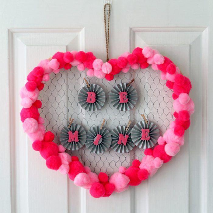 """<p>Funky and fabulous, this project utilizes chicken wire and pom-poms for a fast craft that's great if you need a last-minute wreath.</p><p><strong>Get the tutorial at <a href=""""https://www.thecountrychiccottage.net/quick-valentines-day-wreath-idea/"""" rel=""""nofollow noopener"""" target=""""_blank"""" data-ylk=""""slk:The Country Chic Cottage"""" class=""""link rapid-noclick-resp"""">The Country Chic Cottage</a>.</strong></p><p><a class=""""link rapid-noclick-resp"""" href=""""https://www.amazon.com/Craft-Poms-Light-Pink-inch/dp/B07KPN7WW8?tag=syn-yahoo-20&ascsubtag=%5Bartid%7C10050.g.35057743%5Bsrc%7Cyahoo-us"""" rel=""""nofollow noopener"""" target=""""_blank"""" data-ylk=""""slk:SHOP POM POMS"""">SHOP POM POMS</a><br></p>"""
