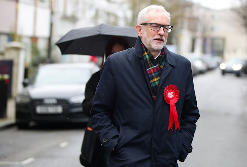 Britain's opposition Labour Party leader Jeremy Corbyn walks to a polling station to vote in the general election in London, Britain, December 12, 2019. REUTERS/Lisi Niesner