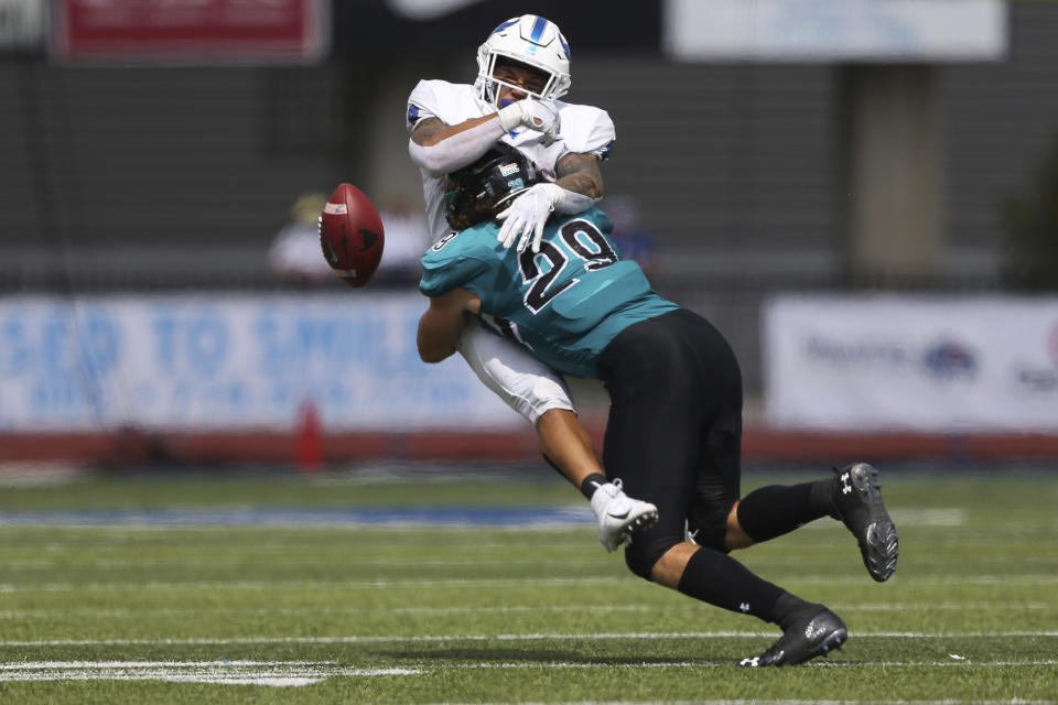 Coastal Carolina linebacker Silas Kelly (29) breaks up a pass intended for Buffalo wide receiver Dylan McDuffie during the first half of a NCAA college football game in Buffalo, N.Y. on Saturday, Sept. 18, 2021. (AP Photo/Joshua Bessex)