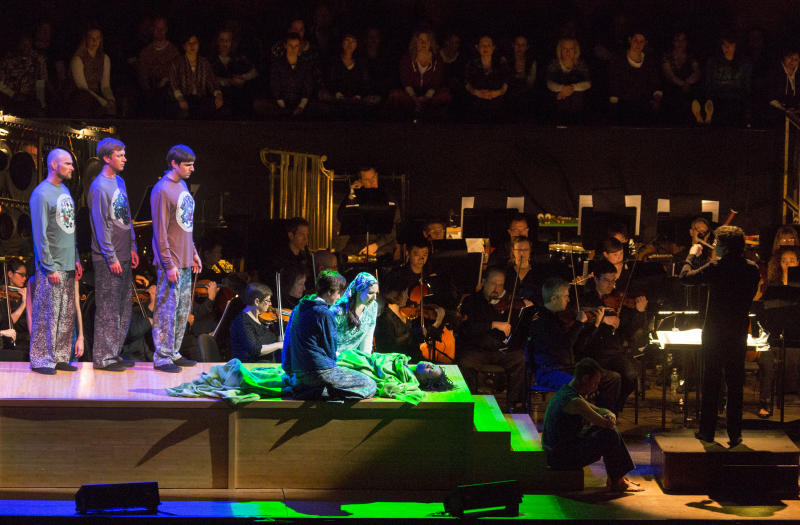 """In this photo provided by Lincoln Center for the Performing Arts, the cast and orchestra is seen together during Act 1, Scene 3, """"Lazarus"""" during a performance of """"The Gospel According to the Other Mary"""" at Avery Fisher Hall at New York's at Lincoln Center, Wednesday, March 27, 2013. (AP Photo/Lincoln Center for the Performing Arts, Richard Termine)"""