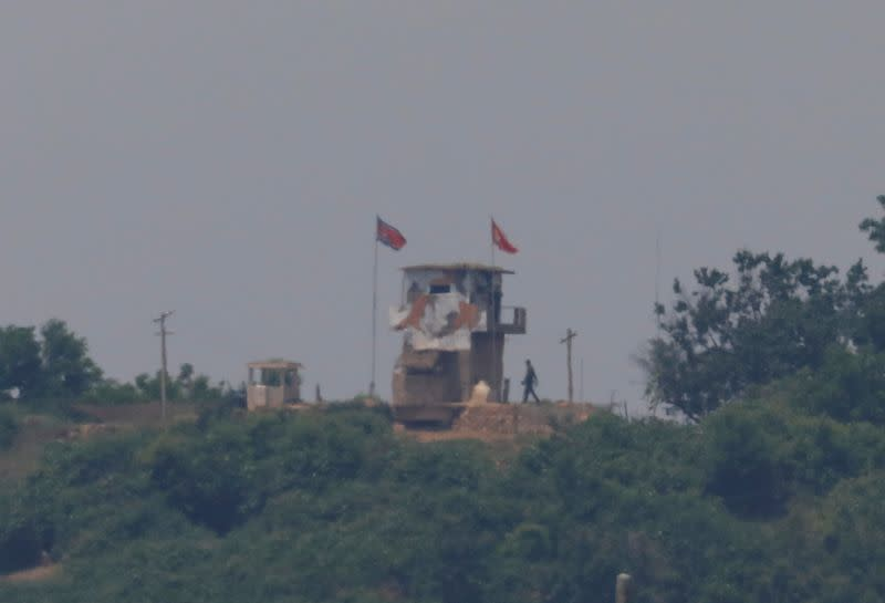 A North Korean soldier is seen beside his guard post inside North Korean territory in this picture taken near the demilitarized zone separating the two Koreas in Paju