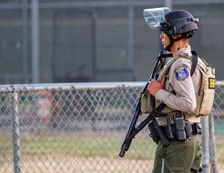 A police officer stands watch at the scene of a mass shooting during the Gilroy Garlic Festival in Gilroy, California