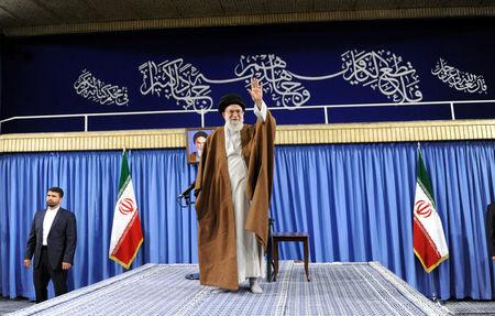 Iran's Supreme Leader Ayatollah Ali Khamenei waves before speaking to the audience in Tehran