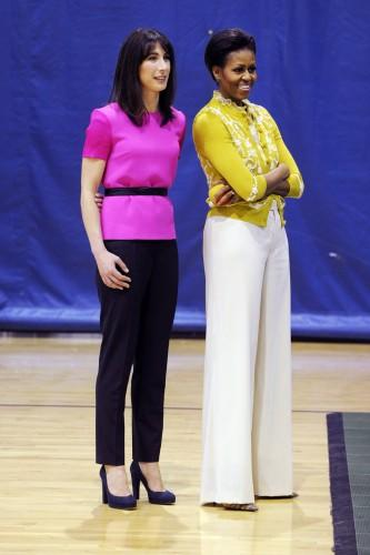 """<div class=""""caption-credit""""> Photo by: Rex USA</div><div class=""""caption-title""""></div>Not many gals can pull off an embellished chartreuse sweater set, but the first lady is crushing it in the vibrant hue and wide-leg trousers. It probably doesn't hurt that Samantha Cameron, wife of British Prime Minister David Cameron and fashion maven in her own right, is sporting an equally eye-popping shade. <br> <br>"""