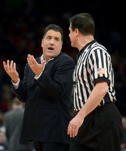 St. John's head coach Steve Lavin talks with referee Wally Rutecki in the first half of their NCAA college basketball game against Pittsburgh at Madison Square Garden in New York, Sunday, Feb. 24, 2013. (AP Photo/Henny Ray Abrams)
