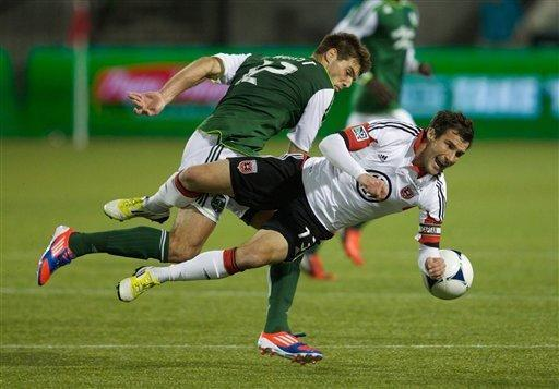 Timbers defender #12 David Horst sends DC United forward #13 Chris Pontius to the ground near the Timbers' goal and is called for a foul Saturday Sept. 29, 2012. The Portland Timbers and DC United played to a 1-1 tie at Jeld-Wen Field. (AP Photo/Doug Beghtel, The Oregonian)
