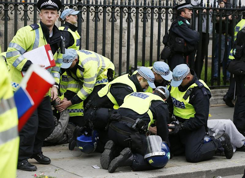 British police officers arrest anti-fascist demonstrators protesting against members of the British National Party (BNP), not seen, during a demonstration in central London, Saturday, June.1, 2013. BNP supporters gathered to protest the May 22 killing of British soldier Lee Rigby. (AP Photo/Lefteris Pitarakis)