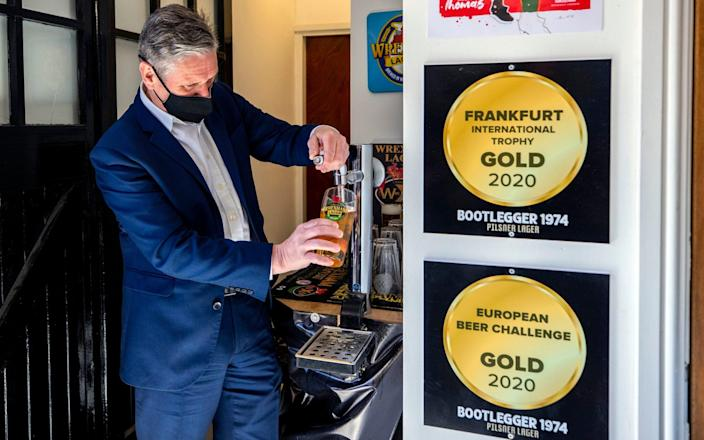 Sir Keir Starmer ensures there are no more awkward run-ins with pub landlords - by pulling his own pint - PA