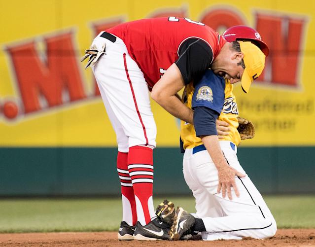 <p>Democrats' shortstop Rep. Tim Ryan, D-Ohio, gives Rep. Jack Bergman, R-Mich., a hug after a play at second base during the annual Congressional Baseball Game at Nationals Park in Washington on Thursday, June 15, 2017. (Photo: Bill Clark/CQ Roll Call/Getty Images) </p>