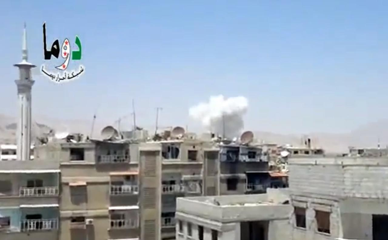 """In this image taken from video obtained from the Shaam News Network, which has been authenticated based on its contents and other AP reporting, columns of smoke billow above houses as a result of heavy bombing in Damascus, Syria, Monday July 22, 2013. Syrian rebels seized a strategic village on the edge of the northern city of Aleppo on Monday, activists said, just hours after other opposition fighters sustained some of their heaviest losses in months in battles to the south near the capital, Damascus. Logo: reads, """"Douma Network – Free People of Douma."""" (AP Photo/Shaam News Network via AP video)"""