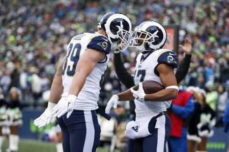 Dec 17, 2017; Seattle, WA, USA; Los Angeles Rams wide receiver Robert Woods (17) celebrates with tight end Tyler Higbee (89) after catching a touchdown pass against the Seattle Seahawks during the second quarter at CenturyLink Field. Mandatory Credit: Joe Nicholson-USA TODAY Sports