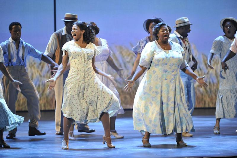 "Audra McDonald, left, and the cast of ""The Gershwins' Porgy and Bess,"" perform at the 66th Annual Tony Awards on Sunday June 10, 2012, in New York. The production won a Tony Award for best revival of a musical. (Photo by Charles Sykes /Invision/AP)"