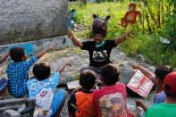Environmentalist fights Indonesia's coastal erosion with fairy tales, puppet shows and mangrove saplings