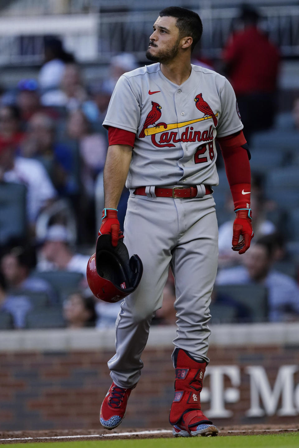 St. Louis Cardinals' Nolan Arenado walks back to the dugout after striking out to end the Cardinals' half of the fourth inning of a baseball game against the Atlanta Braves on Thursday, June 17, 2021, in Atlanta. (AP Photo/John Bazemore)