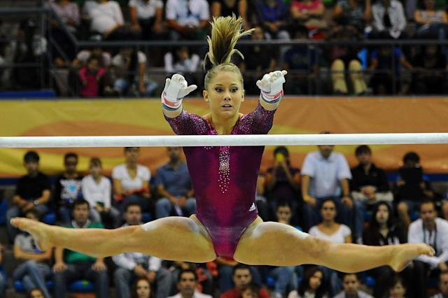 GUADALAJARA, MEXICO - OCTOBER 27: Shawn Johnson of the United States competes in the Women's Artistic Gymnastics Finals in Uneven Bars during Day 13 of the XVI Pan American Games at the Revolution Sports Complex on October 27, 2011 in Guadalajara, Mexico. (Photo by Dennis Grombkowski/Getty Images)