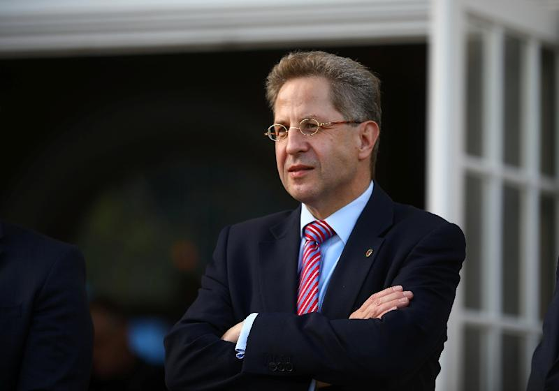German top domestic spy Hans-Georg Maassen's questioning of the authenticity of a video purporting to show a 'hunt against foreigners' has set him directly against Chancellor Angela Merkel (AFP Photo/HANNIBAL HANSCHKE)