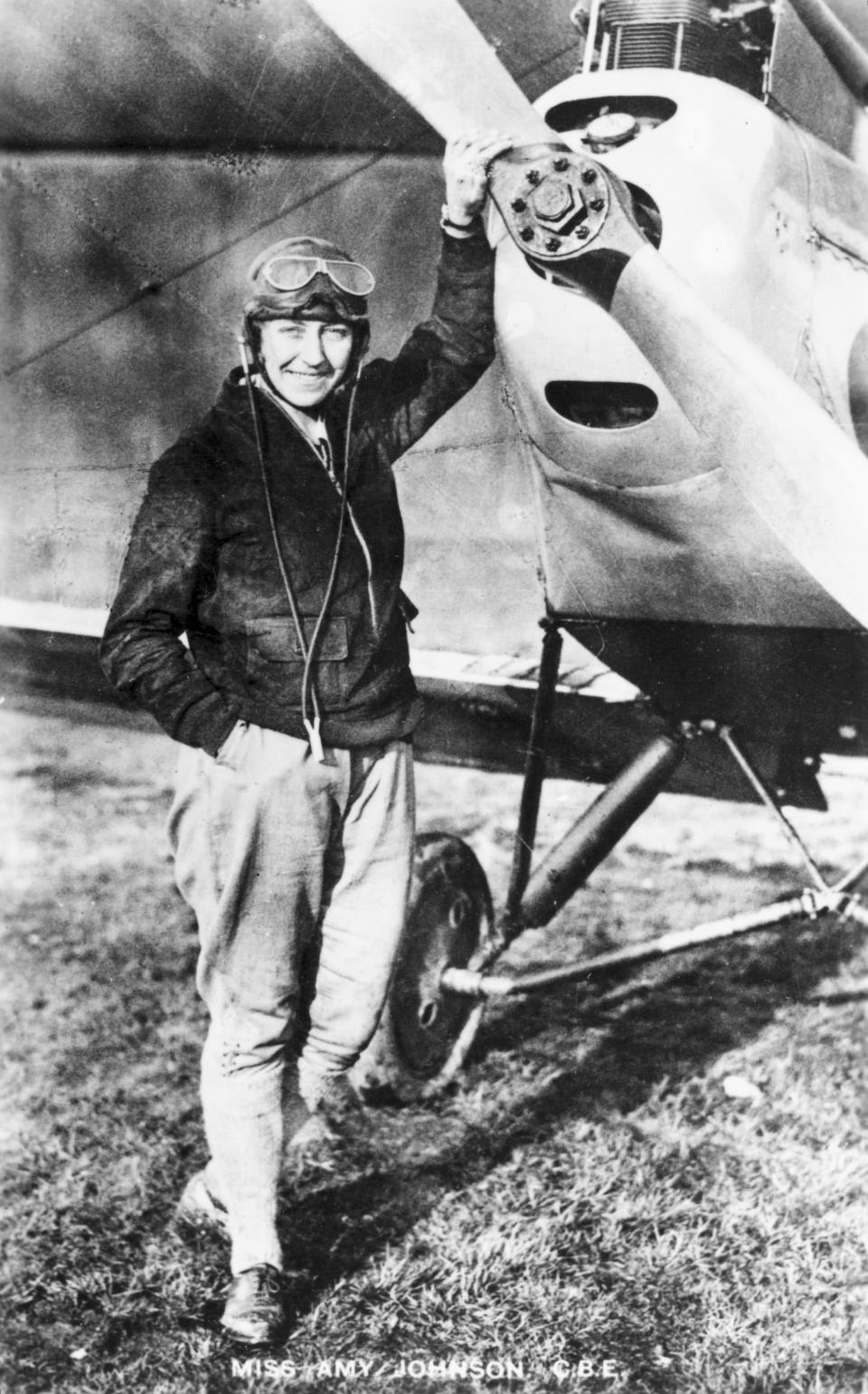 English aviatorJohnson in her flying suit, standing in front of her DH60 Moth aeroplane 'Jason'. In 1930 Johnson (1903-1941) became the first woman to fly solo from England to Australia, winning £10,000 from the 'Daily Mail' newspaper. In 1932, she set a record for the fastest solo flight from England to Cape Town and broke that record four years later. In 1933, with her husband, James Mollison (1905-1959) she flew in a De Havilland biplane non-stop across the Atlantic in 39 hours. She joined the Air Transport Auxilary as a pilot in WWII and died when her plane was lost over the Thames estuary. (Photo: Science & Society Picture Library/SSPL/Getty Images)
