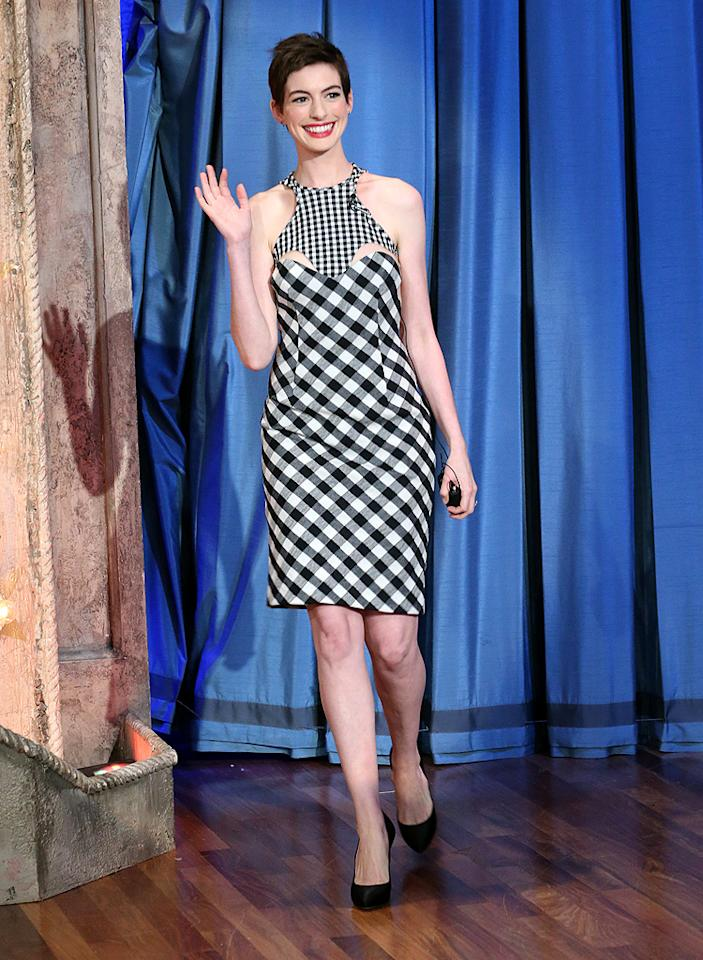 """On Wednesday, <a target=""""_blank"""" href=""""http://omg.yahoo.com/photos/2h2h-0718-slideshow/anne-hathaway-photo-1342643980.html"""">Anne Hathaway looked beyond beautiful at the European premiere of """"The Dark Knight Rises.""""</a> However, a few days earlier -- during an appearance on """"Late Night With Jimmy Fallon"""" -- the Oscar-nominated actress dared to wear this disastrous Stella McCartney eyesore. The frock, which also accentuated her unfortunate 'do, featured a dizzying gingham pattern and creepy cut-outs along the bust. Not even Catwoman could pull this off. (7/13/2012)<br><br><a target=""""_blank"""" href=""""http://bit.ly/lifeontheMlist"""">Follow What Were They Thinking?! creator, Matt Whitfield, on Twitter!</a>"""