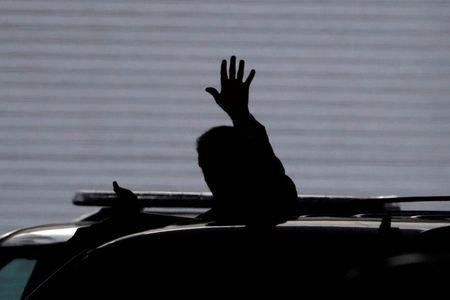 U.S. Republican presidential candidate Donald Trump waves to the media as he leaves the Conrad Hotel in Indianapolis, Indiana July 13, 2016.  REUTERS/Aaron P. Bernstein