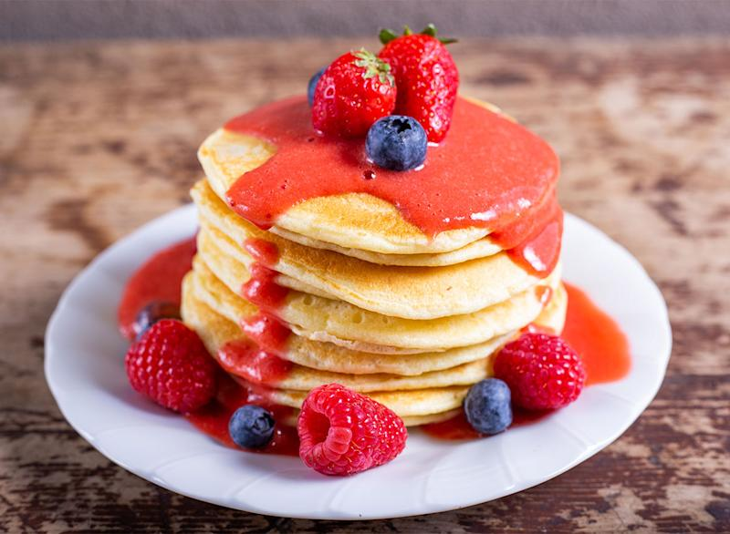 pancakes topped with blueberries and raspberries