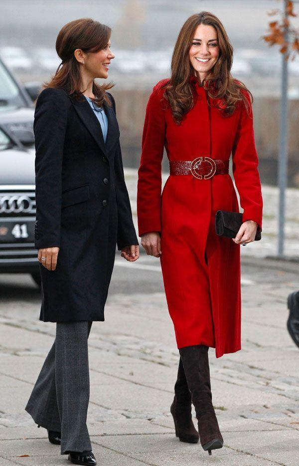 <p>Bold in a red L. K. Bennett coat and boots at a UNICEF Emergency Supply Center in Denmark</p>
