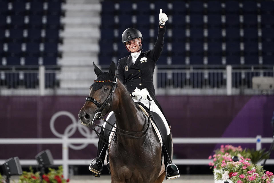 Dressage is as esoteric as sports get, but the music some riders bumped their routines Wednesday made them all the more captivating. (AP Photo/David Goldman)