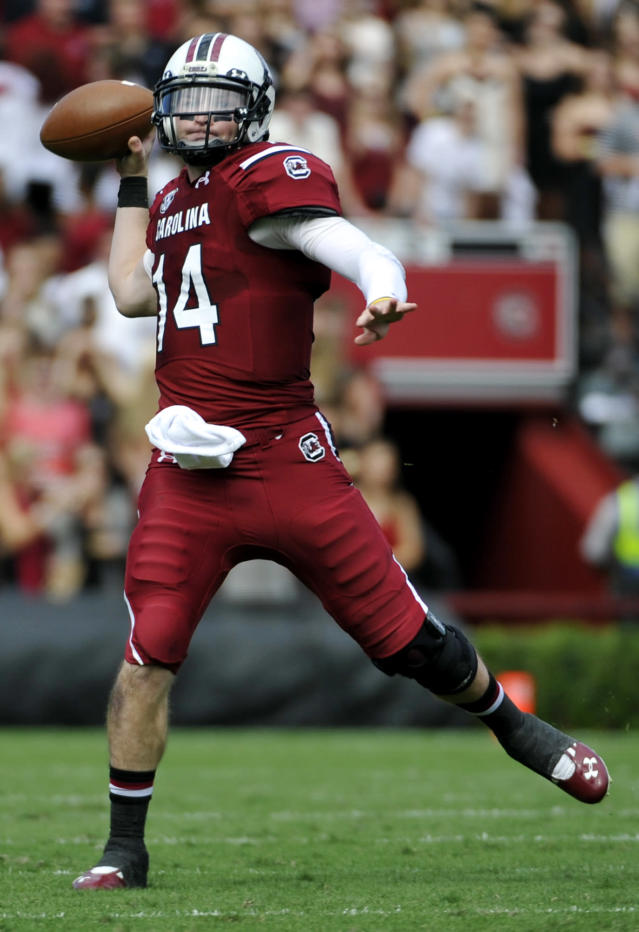 South Carolina quarterback Connor Shaw (14) looks to throw the ball against Mississippi State during the first half of an NCAA football game, Saturday, Nov. 2, 2013, in Columbia, S.C. (AP Photo/Rainier Ehrhardt)