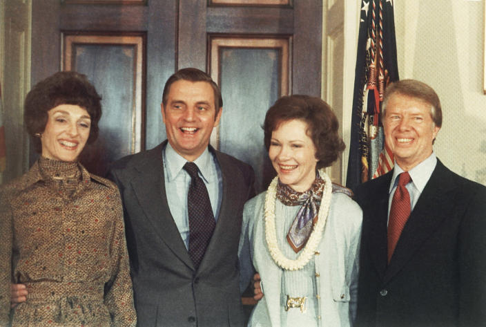 FILE - In this Jan. 21, 1977, file photo, President Jimmy Carter, right, and Rosalynn Carter, second from right, pose with Vice President Walter Mondale and wife, Joan Mondale, left, following Carter's inauguration in the White House Blue Room in Washington. Mondale, a liberal icon who lost the most lopsided presidential election after bluntly telling voters to expect a tax increase if he won, died Monday, April 19, 2021. He was 93. (AP Photo/Peter Bregg, File)