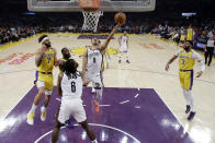 Brooklyn Nets' Timothe Luwawu-Cabarrot (9) drives to the basket against the Los Angeles Lakers during the first half of an NBA basketball game Tuesday, March 10, 2020, in Los Angeles. (AP Photo/Marcio Jose Sanchez)