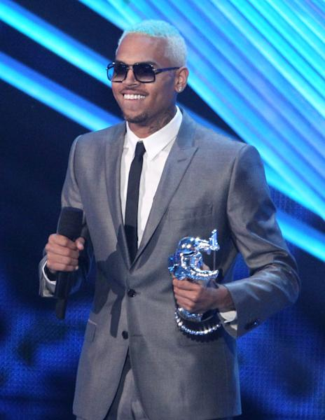 """Chris Brown accepts the award for best male video for """"Turn Up the Music"""" at the MTV Video Music Awards on Thursday, Sept. 6, 2012, in Los Angeles. (Photo by Matt Sayles/Invision/AP)"""