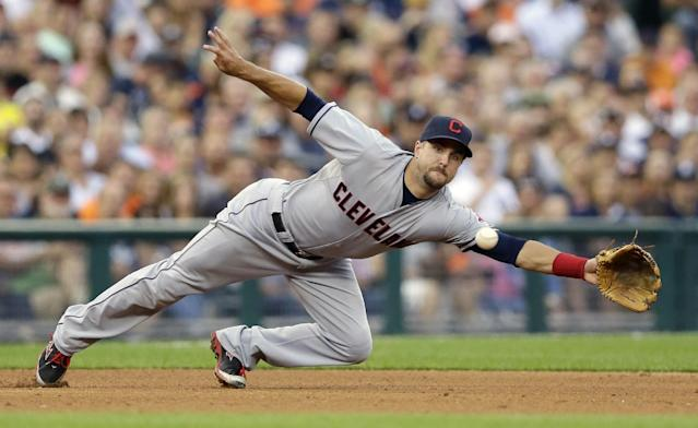 Cleveland Indians third baseman Lonnie Chisenhall dives but misses the single by Detroit Tigers' J.D. Martinez during the fourth inning of a baseball game in Detroit, Friday, July 18, 2014. (AP Photo/Carlos Osorio)