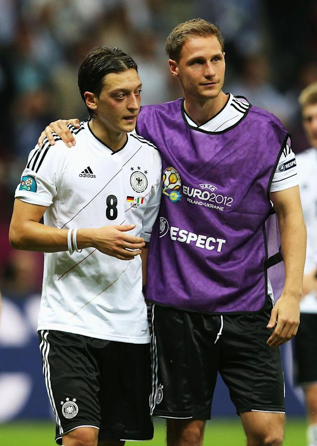 WARSAW, POLAND - JUNE 28: Mesut Ozil (L) and Benedikt Howedes (R) of Germany show their dejection after the UEFA EURO 2012 semi final match between Germany and Italy at the National Stadium on June 28, 2012 in Warsaw, Poland. (Photo by Joern Pollex/Getty Images)