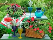 """<div class=""""caption-credit"""">Photo by: Nancy Ondra</div><div class=""""caption-title"""">Picnic Planters</div>When you're not using your picnic table, dress it up with a display of picnic-themed planters, such as plastic pitchers and glasses, colorful serving bowls and, of course, an old picnic basket."""