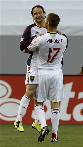 Real Salt Lake defender Chris Wingert (17) lifts midfielder Ned Grabavoy, left, to celebrate Grabovoy scoring a goal against Chivas USA during the first half of an MLS soccer game in Carson, Calif., Sunday, May 19, 2013. (AP Photo/Alex Gallardo)