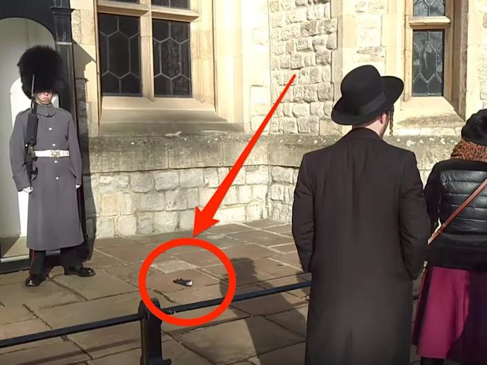 Woman Throwing Glove at Queen's Guard Skitch
