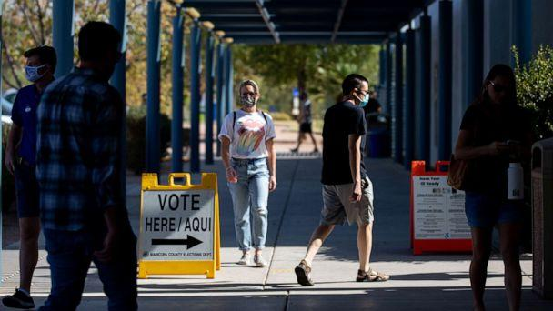 PHOTO: Voters enter Southeast Regional Library to cast their ballots, Nov. 3, 2020 in Gilbert, Ariz.  (Courtney Pedroza/Getty Images)