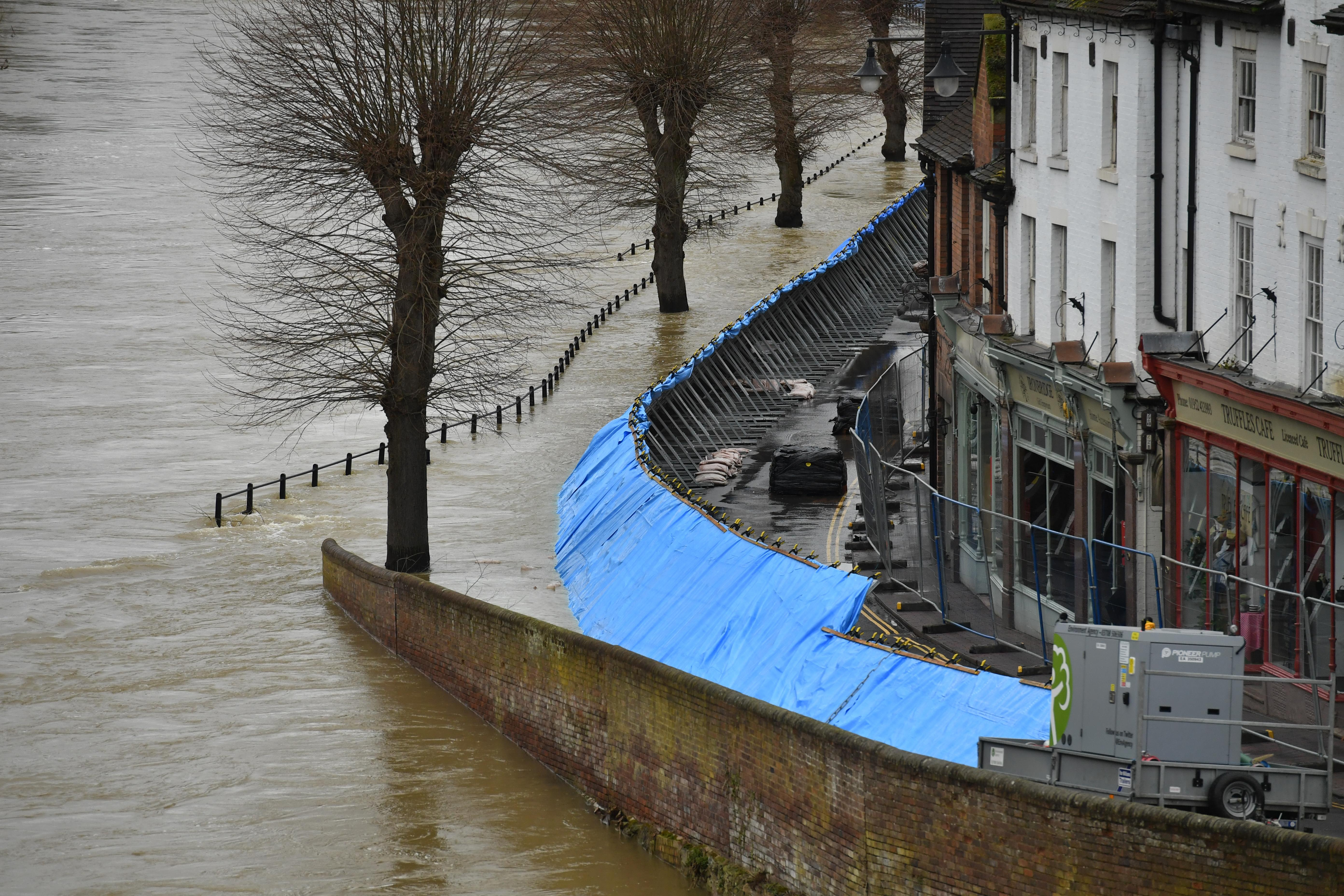 Temporary flood barriers hold back the river Severn in Ironbridge, Shropshire, in the aftermath of Storm Dennis. (Photo by Jacob King/PA Images via Getty Images)