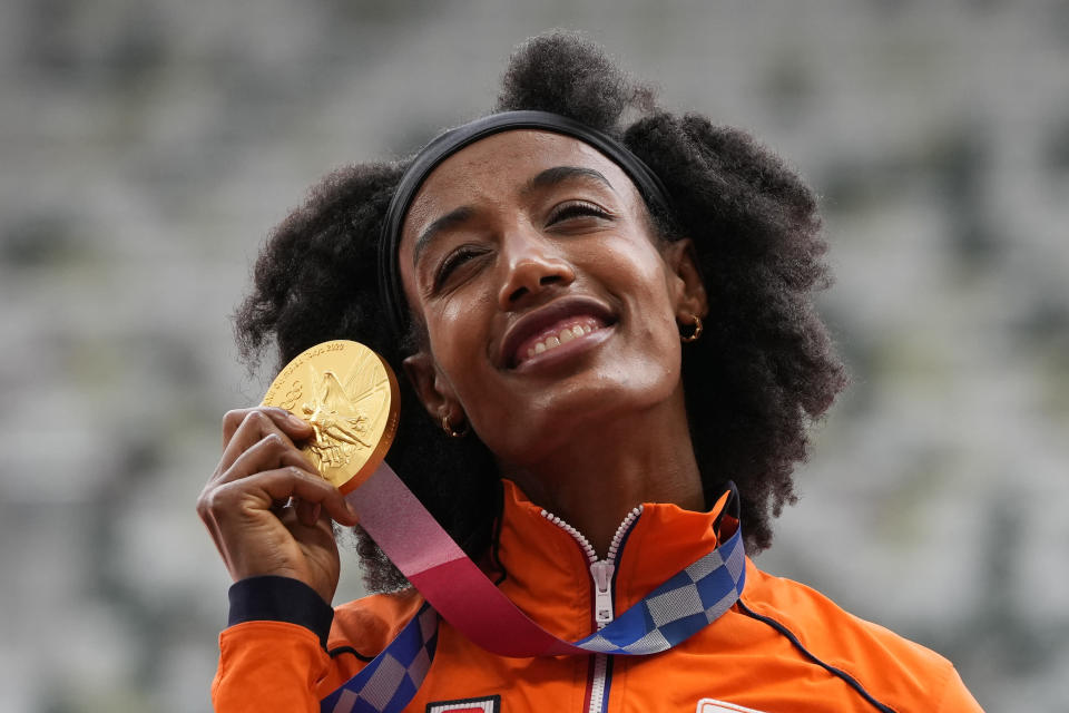 Sifan Hassan, of the Netherlands, holds her gold medal for women's 5,000-meters final at the 2020 Summer Olympics, Tuesday, Aug. 3, 2021, in Tokyo. (AP Photo/Francisco Seco)